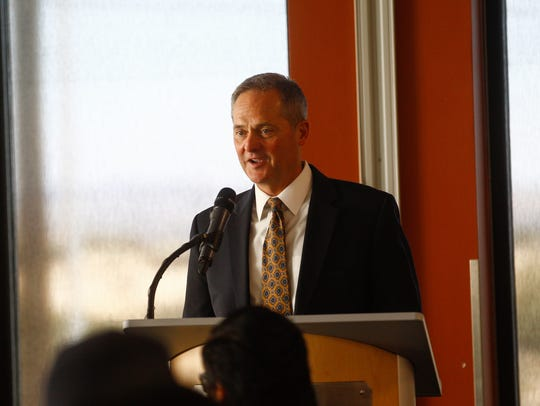 Ron Darnell, senior vice president for public policy at PNM, speaks to scholarship recipients on Tuesday during a ceremony at the San Juan College School of Energy in Farmington.