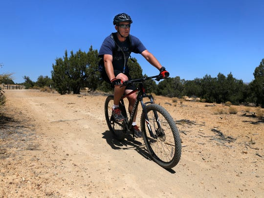 Jon Lillywhite rides the Anasazi Trail in Farmington on Thursday. A Colorado firm is updating a bicycle and pedestrian plan for San Juan County.