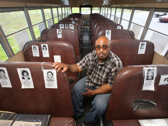 Quinton Higgins in his bus remembering the victims of the Carrollton bus crash.