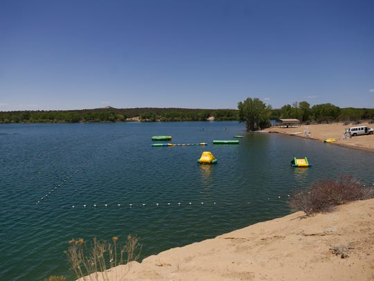 A still-quiet Farmington Lake is pictured on May 18. The lake's popular swim area, the Beach, opens at noon Saturday.