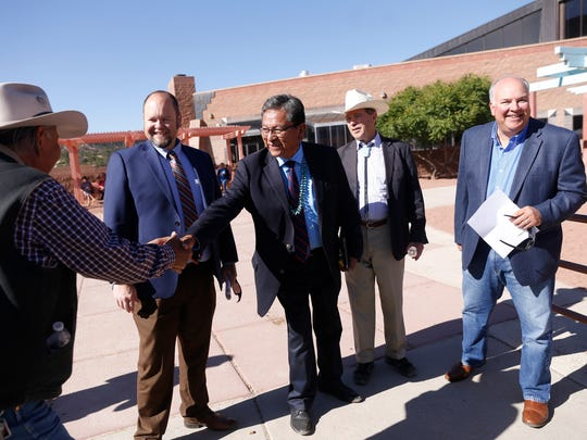Farmington Mayor Nate Duckett, second from left, Navajo Nation President Russell Begaye, U.S. Sen. Tom Udall and Farmington City Manager Rob Mayes greet community members Friday at the Navajo Nation Museum in Window Rock, Arizona.