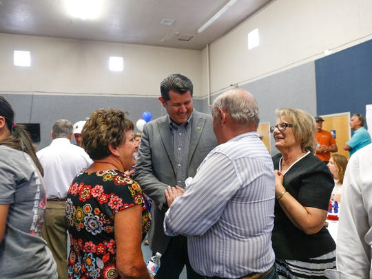 San Juan County sheriff candidate Shane Ferrari talks with supporters Tuesday during his primary election party at the Fraternal Order of Police building in Farmington.