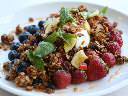 "The ""Cream and Honey,"" burrata, superfood granola and"