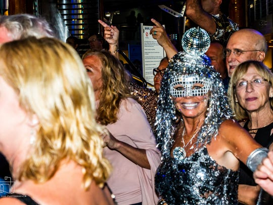 Boogie, oogie, oogie: Guests get down and funky aboard a Star Vista LIVE Cruise.
