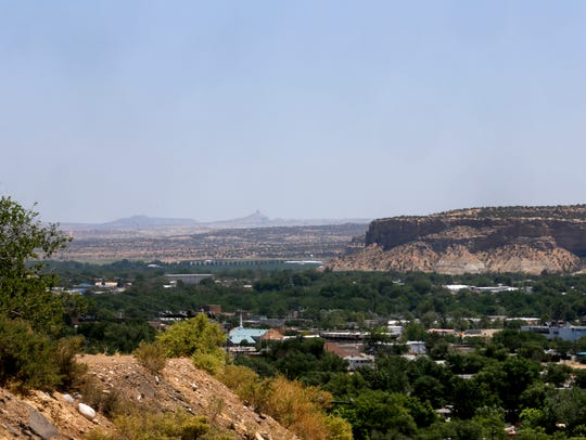 Smoke from Colorado wildfires was in the air Monday in this view from West Navajo Street.