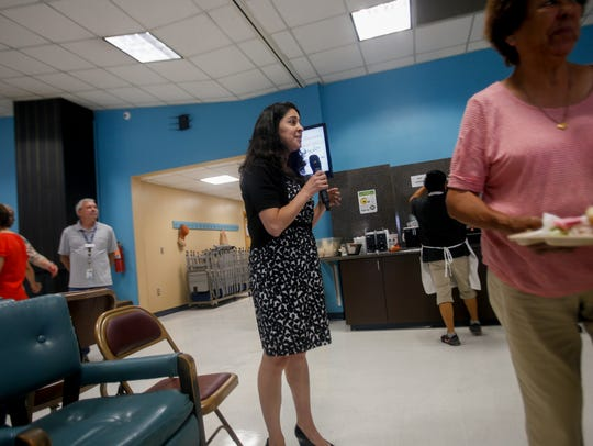 Court of Appeals candidate Briana Zamora talks with local residents Friday during lunch at the Bonnie Dallas Senior Center in Farmington.