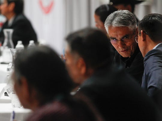 Navajo Nation presidential candidates Joe Shirley Jr, center, and Nick Taylor, right, talk Monday during a Navajo Nation presidential candidates forum at Navajo Technical University in Crownpoint.