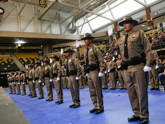 Members of Navajo Police Training Academy Class 52 take their oath of office Friday at Wildcat Den in Chinle, Ariz.