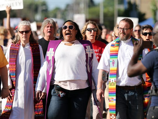 Nicole Hardin, center, marched with others during the