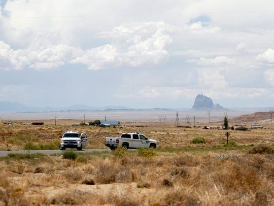 Navajo Nation police close a section of Navajo Route 36 Friday near mile marker 15 in Nenahnezad after a fatal collision.
