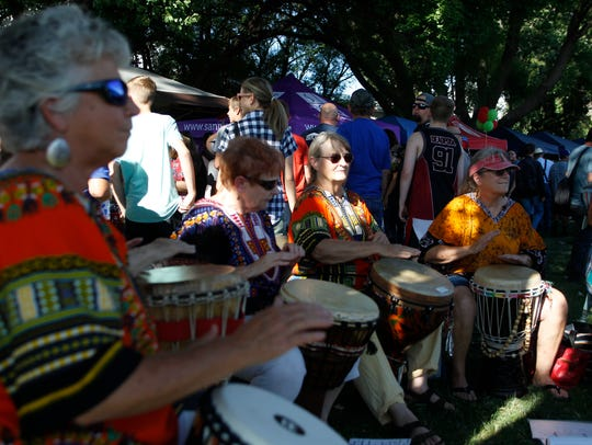Members of the Ashay Drummers perform Tuesday during Aztec's National Night Out event at Minium Park.
