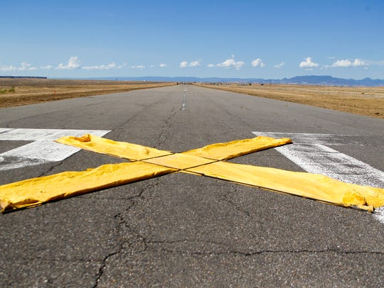 A large X lays on the runway Wednesday at the Shiprock Airstrip.