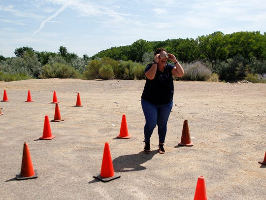 Kira Garcia, a Realtor with Keller Williams Realty, tries on a pair of impairment simulation goggles during the inaugural Realtor Rally hosted by the San Juan County Board of REALTORS at the Farmington Museum at Gateway Park.