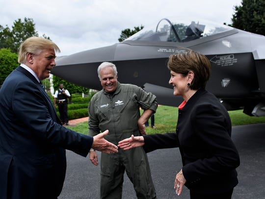 President Donald Trump  shakes hands with Lockheed