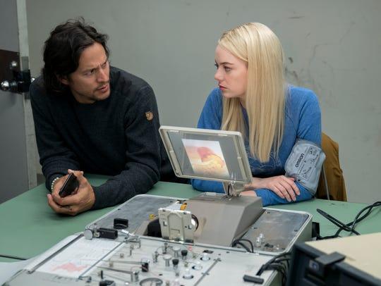 Director Cary Joji Fukunaga, left, and Emma Stone on