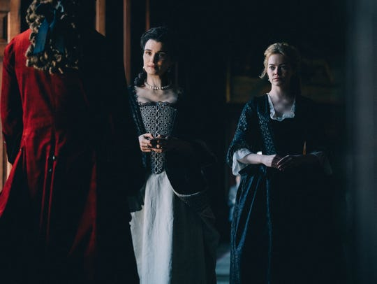 Sarah (Rachel Weisz, left) finds herself struggling to stay in the queen's favor when her conniving cousin Abigail (Emma Stone) comes to work at the palace.