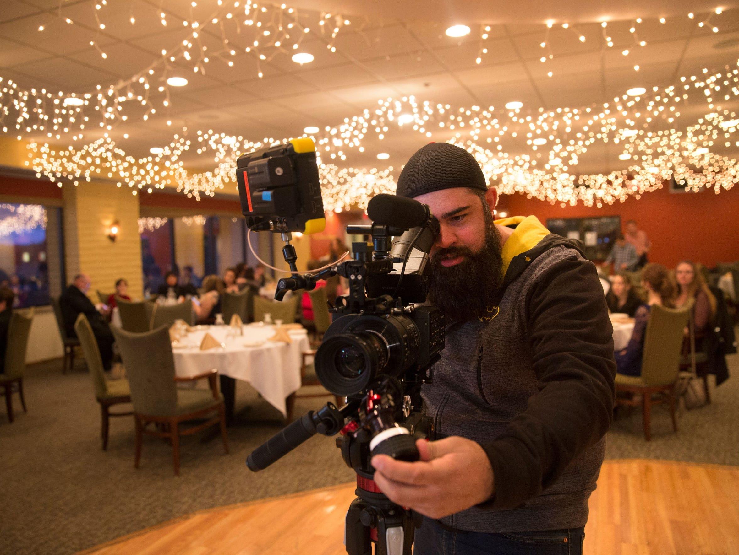 Director Brent Garcia frames a shot during filming