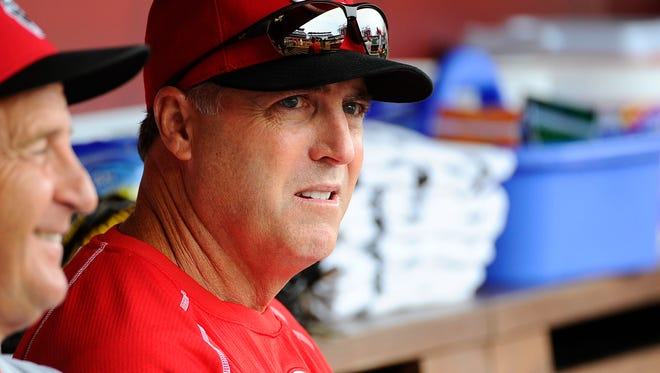 Reds manager Bryan Price sits in the dugout before the July 3 game against the Washington Nationals at Nationals Park.