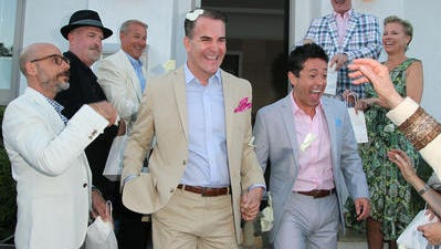 Daniel McFadden, left, and J. Charles McFadden get married at their home in West Hollywood on Aug. 17.