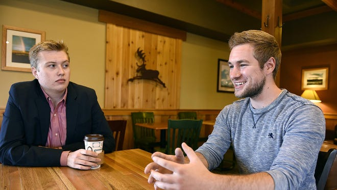 Sam LaBine and Kelvin Schutz talk Sept. 3 about the Startup Weekend to be held Nov. 6-8 at St. John's University.