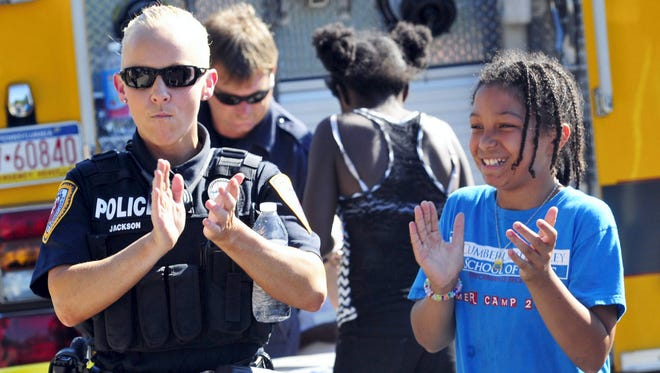 Chambersburg patrolman Jaime Jackson dances with Imyree Teal during the 2015 National Night Out celebration in Chambersburg. This year's event is set for Tuesday, Aug. 2, in the Meadow Creek development.