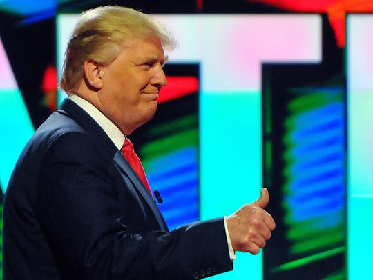 Donald Trump gives a thumbs-up during the Republican