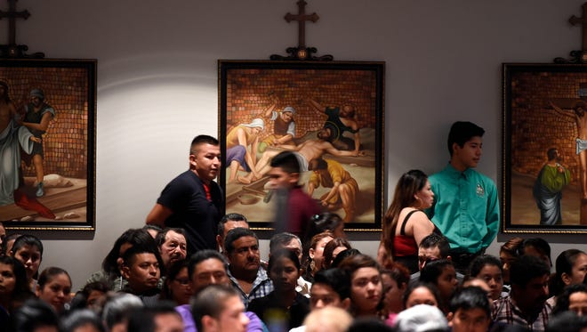 Crowds in the Sagrado Corazon congregation  line the back rows as everyone is looking for a seat on Oct. 2, 2016.