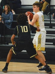 Abilene High's MItchell Watts looks for somewhere to go with the ball while being defended by Keller Fossil Ridge's Marcos Carlis during the Eagles' 64-53 loss Tuesday at Eagle Gym.