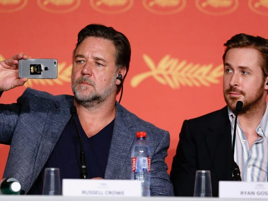 """You can tell these guys like each other. Russell Crowe (left) and Ryan Gosling enjoy themsleves at a press conference for """"The Nice Guys"""" in Cannes, France, on May 15, 2016."""