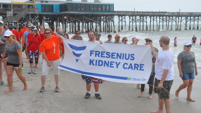 Hundreds showed up at the Cocoa Beach Pier Saturday morning for a paddle out and the Footprints in the Sand Kidney Walk, part of the  National Kidney Foundation's largest walk to fight kidney disease.