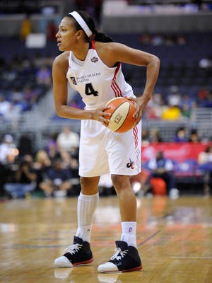 FILE - Marissa Coleman (4), shown here in 2011 as a member of the Washington Mystics, signed with the Indiana Fever Friday.