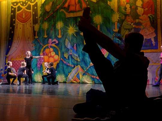 Young dancers from Miss Linda's School of Dance, who will play mice, rehearse Wednesday on the Mansfield Theater stage.
