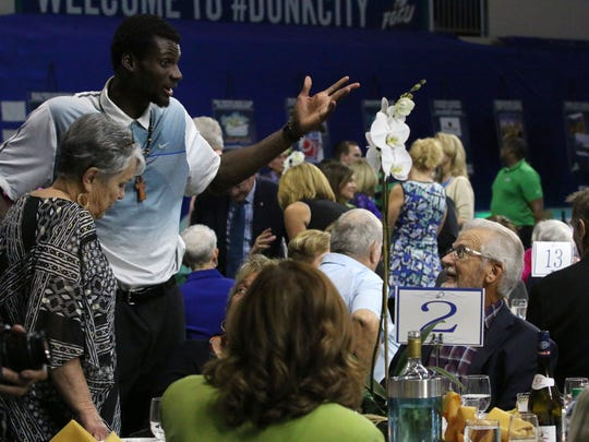 FGCU men's basketball player Marc-Eddy Norelia chats with fans during FGCU's annual Night at the Nest Gala to raise money for the athletic department on Friday, Dec . 2, 2016. Attendees were able to participate in the silent auction, live auction while being served dinner by FGCU student-athletes.