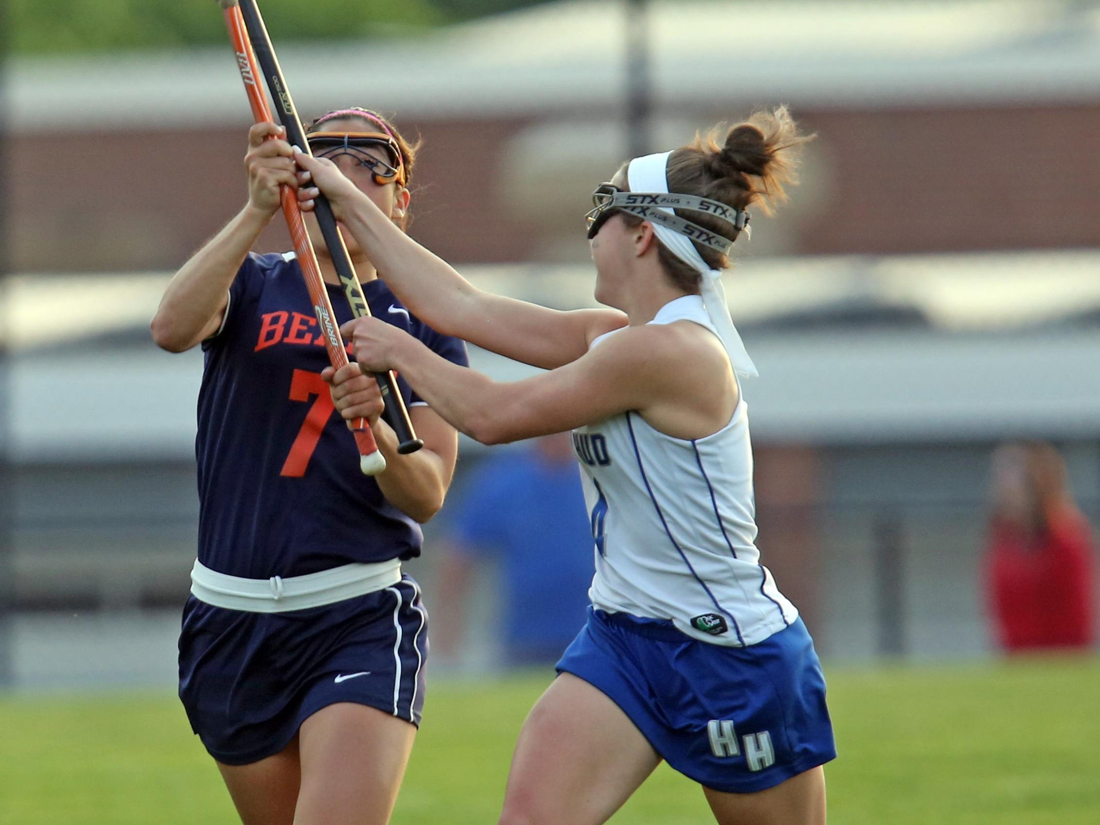 Hendrick Hudson's Montana Garrett (4) tries to steal the ball from Briarcliff's Lexi Grasso (7) during girls lacrosse game at Hendrick Hudson High School in Montrose May 11, 2016.