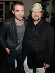 Robert Pattinson, left, poses with director/writer James Toback at the screening of Toback's documentary 'Seduced and Abandoned' in 2013 in Beverly Hills.