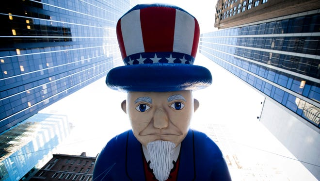 A giant Uncle Sam balloon is marched down Sixth Avenue during the Macy's Thanksgiving Day Parade in New York in November, 2013.