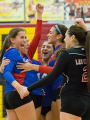 Las Cruces High School's volleyball team members celebrate  during the district championship match at Centennial High School on Saturday, November 4, 2017.