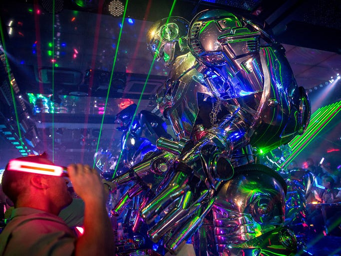 A huge robot performs for customers during a June 29 show at The Robot Restaurant in Tokyo. The restaurant opened two years ago in the Kabukicho area of Shinjuku.