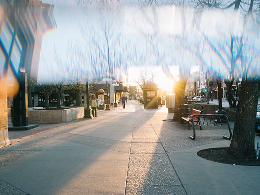 Golden hour strikes the pedestrian mall downtown on