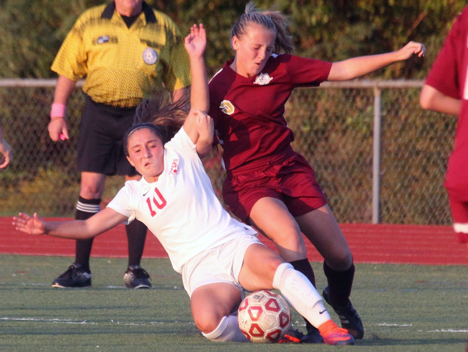 Somers' Jessica Rodriguez, left, is pressured by Arlington's Kendall Feighan during their game at Somers Oct. 17, 2016. Arlington won 2-1 in overtime.