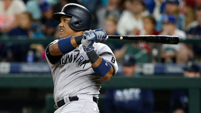 Yankees' Starlin Castro watching his solo home run against Seattle in 2016.