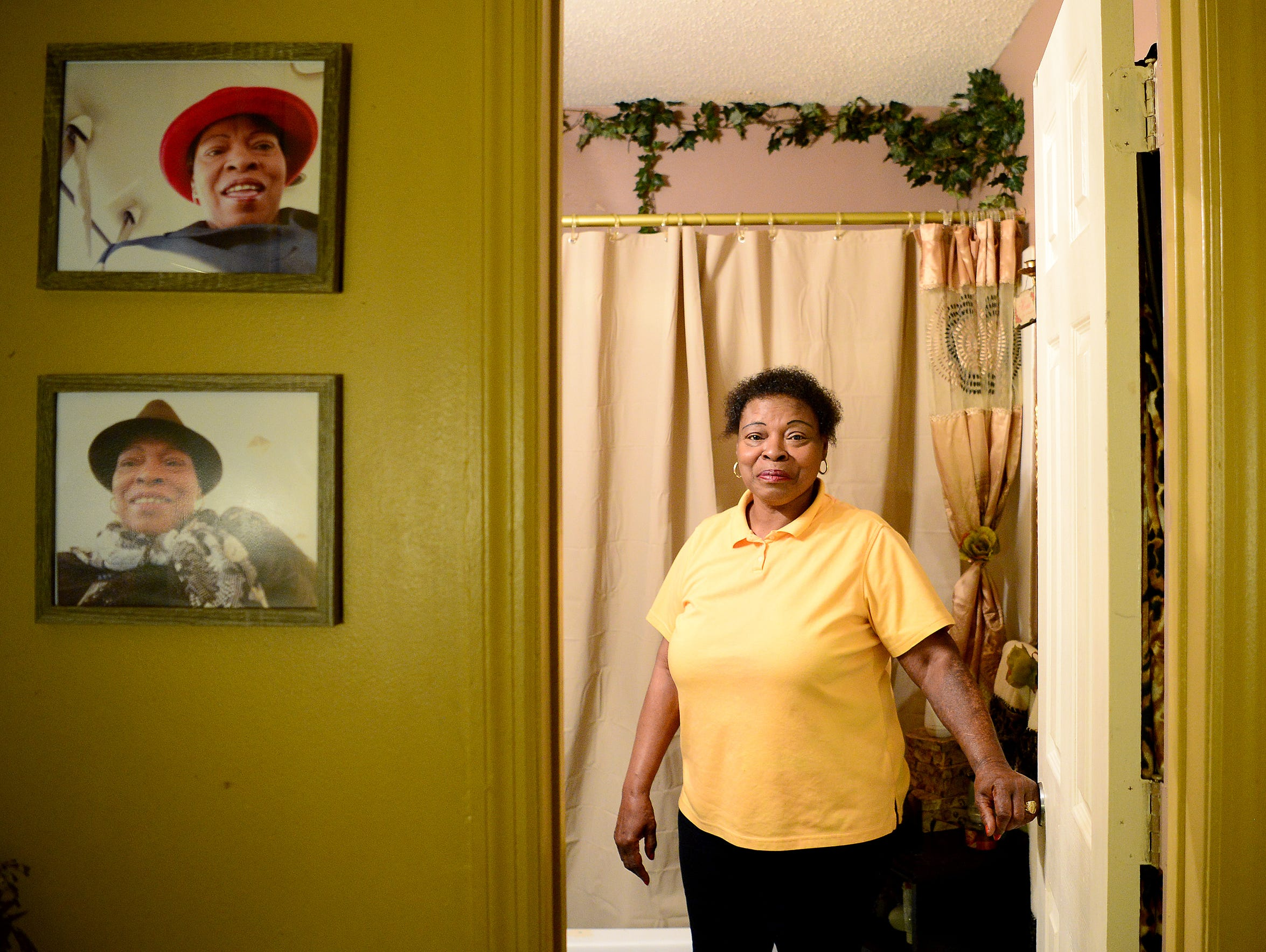 Deaverview resident Lynette Lyles stands in her bathroom,