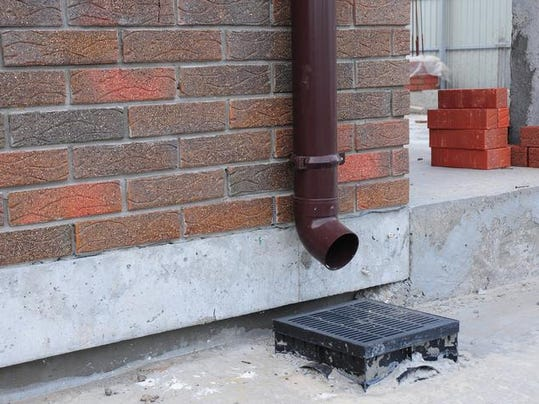 Rain gutter system is designed to catch and remove water