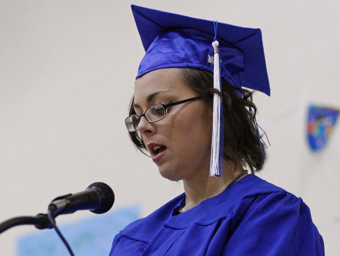 Angel Whisper reads a poem that she received recognition for during the Three Lakes High School graduation, at the Oak Creek Youth Correction Facility, in Albany, on Friday, June 13, 2014.