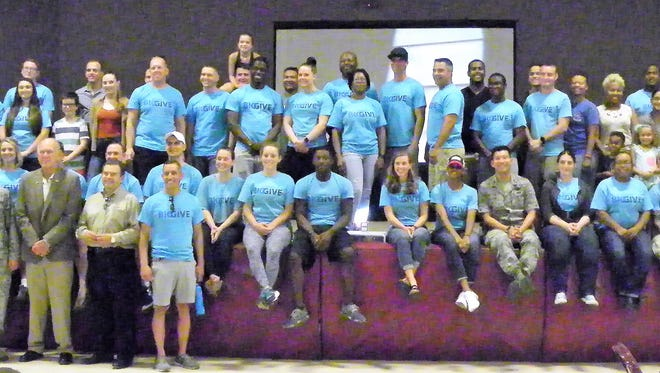 Holloman's Big Give celebrated its eleventh year with an after party for volunteers and the projects they completed for the community. Pictured are the Big Give volunteers in attendance at the Big Give After Party Thursday.