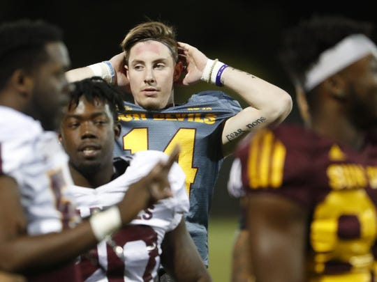 ASU's Ryan Kelley (14) warms up during a spring practice at Kajikawa practice fields on March 16, 2018 in Tempe, Ariz.