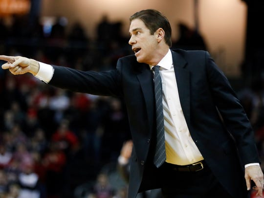 SMU head coach Tim Jankovich directs his players from the bench in the first half of an NCAA college basketball game against Cincinnati, Sunday, Jan. 7, 2018, in Highland Heights, Ky. (AP Photo/John Minchillo)