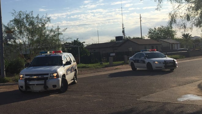 Police were at the scene of a reported robbery in the 3700 block of East Fillmore Street in Phoenix on Aug. 16, 2016.