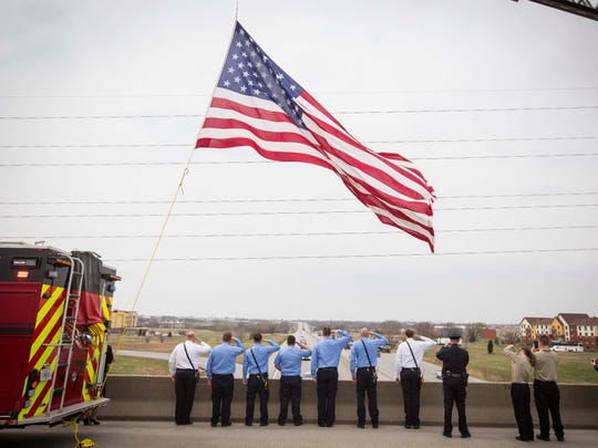 Grimes firefighters salute on the 86th Street overpass