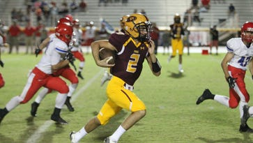 Mountain Pointe High School quarterback Jack Smith rushes the football in Phoenix, Arizona on October 16,  2015.